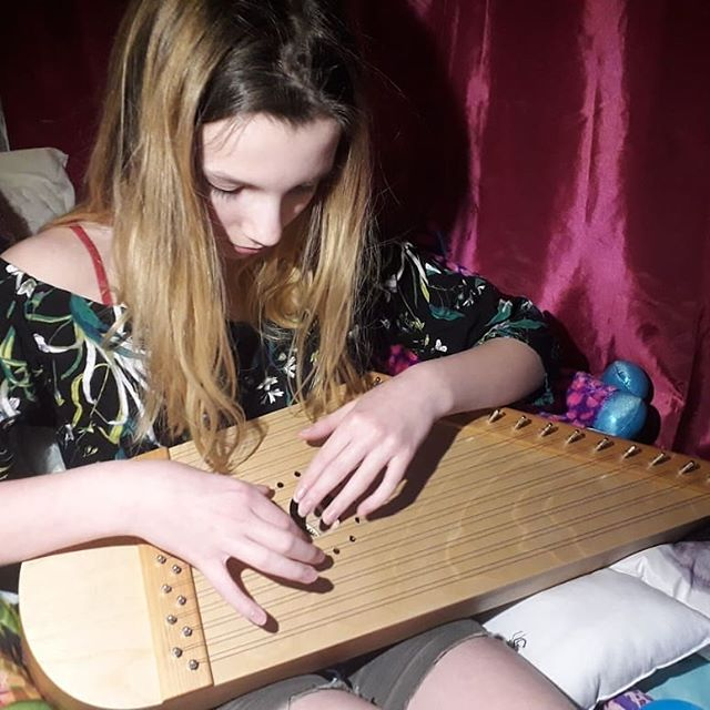 Finnish girl playing a 15 string kantele by Melodia Soitin.