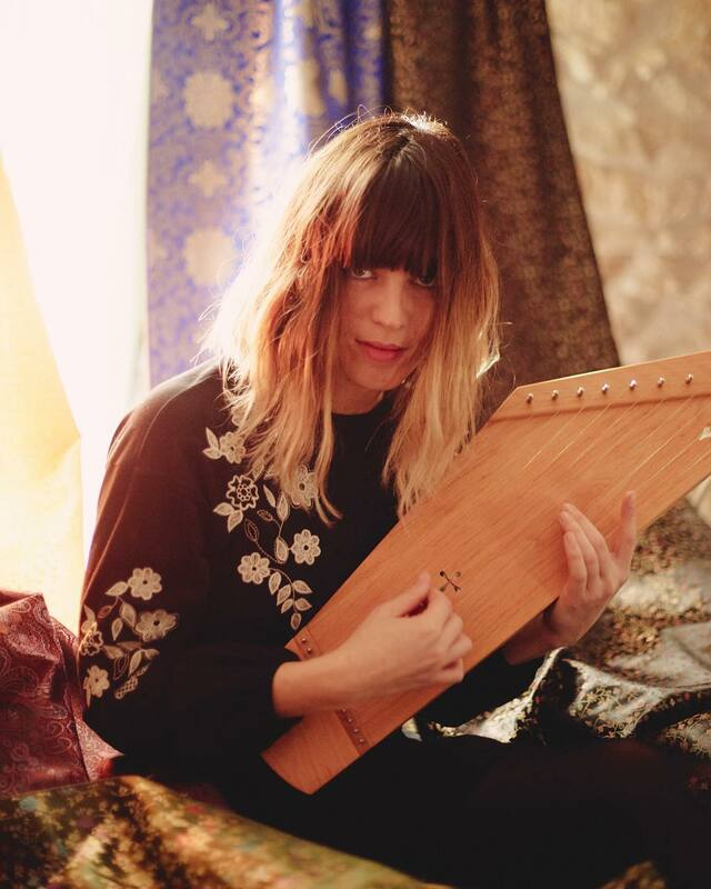 Melody Prochet with her 11 string kantele built by Melodia Soitin.